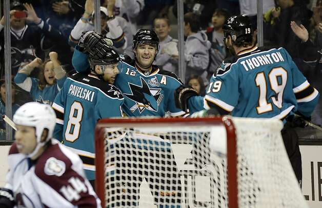 Patrick Marleau celebrates his fourth two-goal game of 2013 with Joe Pavelski (8) and Joe Thornton (19). Photo: Marcio Jose Sanchez, Associated Press