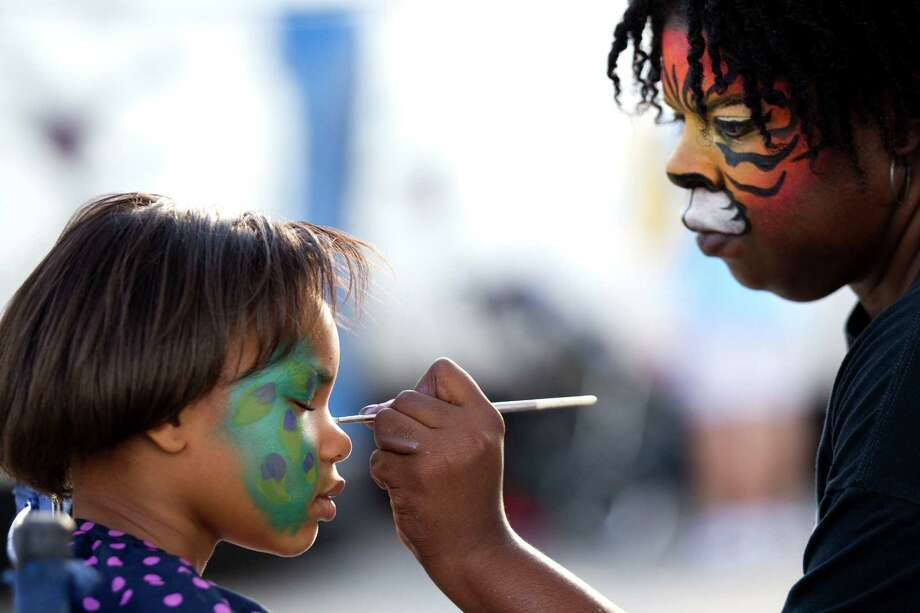 Mackenzie Davis, left, has her face painted by Audra Marie during Winterfest at the Pearland Recreation Center and Natatorium Saturday, Jan. 26, 2013, in Pearland. Photo: Brett Coomer, Houston Chronicle / © 2013 Houston Chronicle