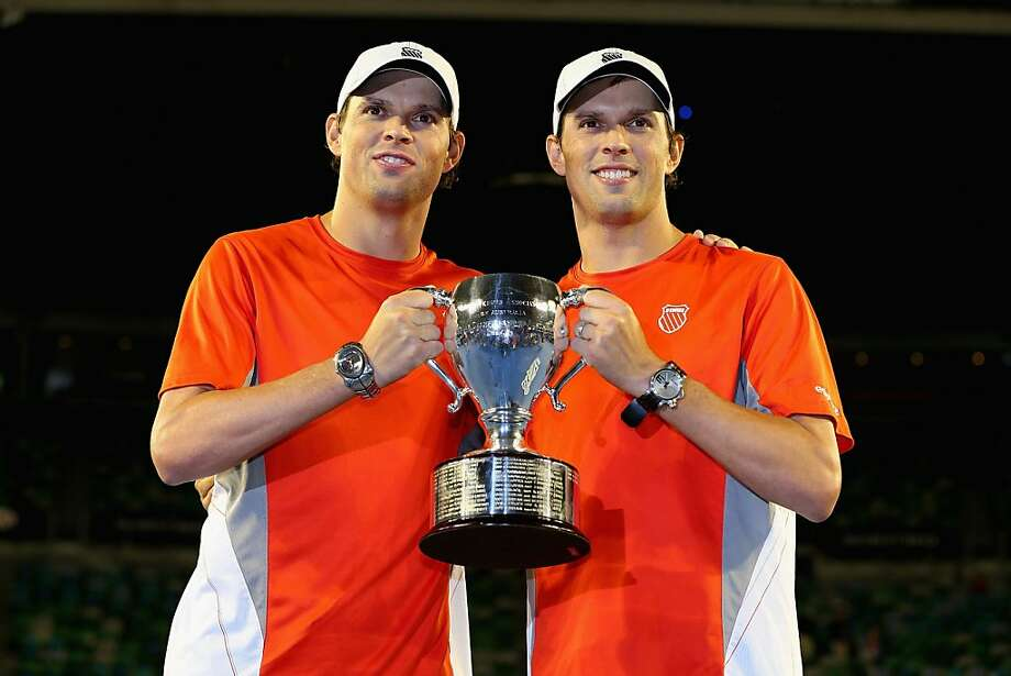 MELBOURNE, AUSTRALIA - JANUARY 26:  Bob Bryan of the United States and Mike Bryan of the United States celebrate with the championship trophy after winning their doubles final match against Robin Haase of the Netherlands and Igor Sijsling of the Netherlands during day thirteen of the 2013 Australian Open at Melbourne Park on January 26, 2013 in Melbourne, Australia.  (Photo by Michael Dodge/Getty Images) Photo: Michael Dodge, Getty Images