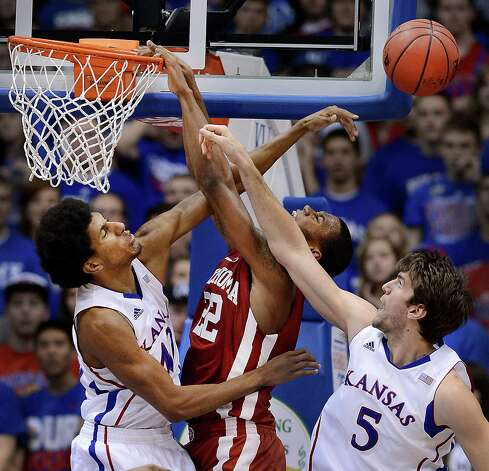 Kansas' Kevin Young, left, and teammate Jeff Withey (5) reject a dunk attempt by Oklahoma's Amath M'Baye during the second half at Allen Fieldhouse in Lawrence, Kansas, on Saturday, January 26, 2013. Kansas won, 67-54. (Rich Sugg/Kansas City Star/MCT) Photo: Rich Sugg, McClatchy-Tribune News Service / Kansas City Star