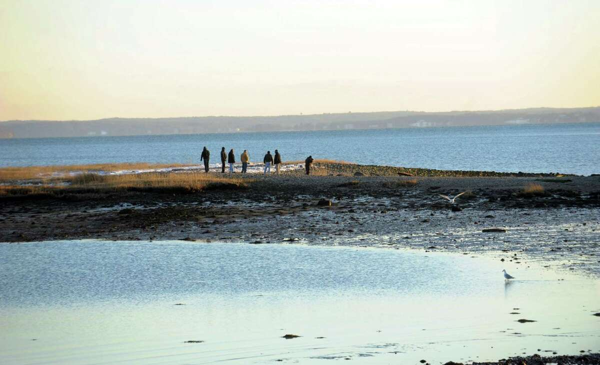 Stamford Police respond to Cove Island Park near Thomas F.J. Quigley Beach where the body of Frank Kuleba, 50, of Norwalk, was found Saturday, January 26, 2013.