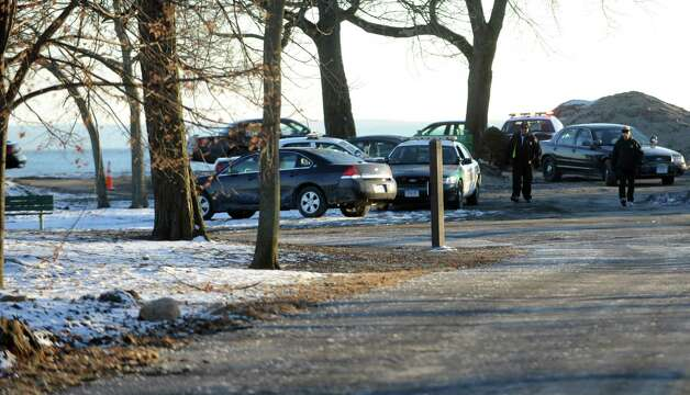Stamford Police respond to Cove Island Park near Thomas F.J. Quigley Beach where the body of Frank Kuleba, 50, of Norwalk, was found Saturday, January 26, 2013. Photo: Lindsay Perry / Stamford Advocate