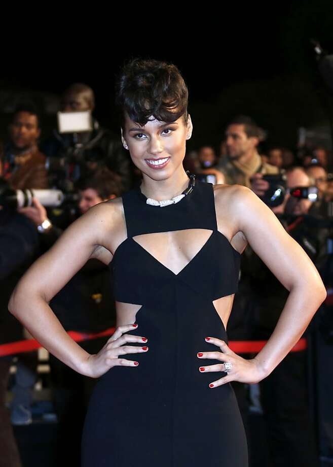 Can Alicia Keys break 2 minutes, 15 seconds in the national anthem? Will she play piano, too? Photo: Valery Hache, AFP/Getty Images