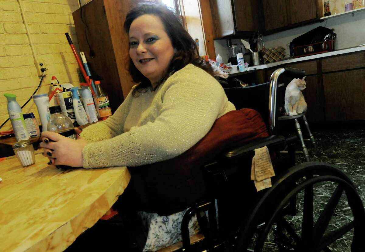 Tammy Reed, who is known as Angel, talks about undergoing a hemicorporectomy, a radical surgery that cut her in half from her belly button down and reduced her from 5-foot-7 to 2-foot-11 to save her life last year at Albany Medical Center Hospital. She has spent the past year at her apartmentin Mechanicville, NY where she lives with her son, John, on Friday Oct. 7, 2011. (Michael P. Farrell/Times Union)