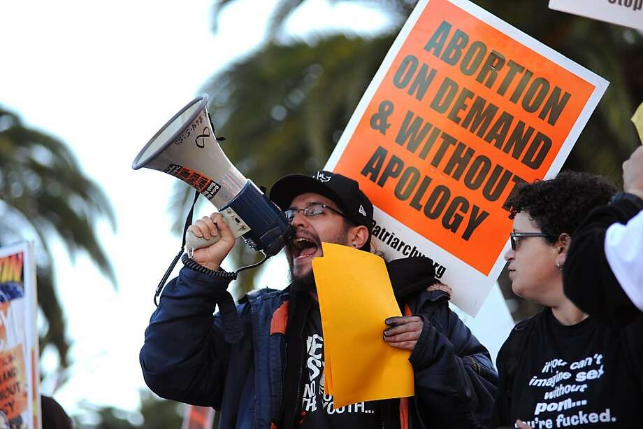 Opi Santos of Stop Patriarchy directs people to march against those opposing abortion at Justin Herman Plaza in S.F. Photo: Michael Short, Special To The Chronicle
