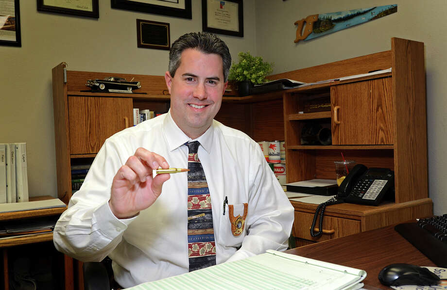 """Sgt. Steven McNeill of the Ector County Sheriff's Dept. poses for a portrait Friday, January 18 in his office while holding a .308 caliber bullet similar to the one that he was shot in the head with during a Sept. 17, 2010 standoff. McNeill says that after being shot his training kicked in and with the help of his partner he was able to stay alert until they were able to be extracted 15 minutes later. """"It's all adrenaline,"""" McNeill said, """"every second felt like a minute."""" James Durbin/Reporter-Telegram Photo: JAMES DURBIN / © 2012 Midland Reporter Telegram. All Rights Reserved."""