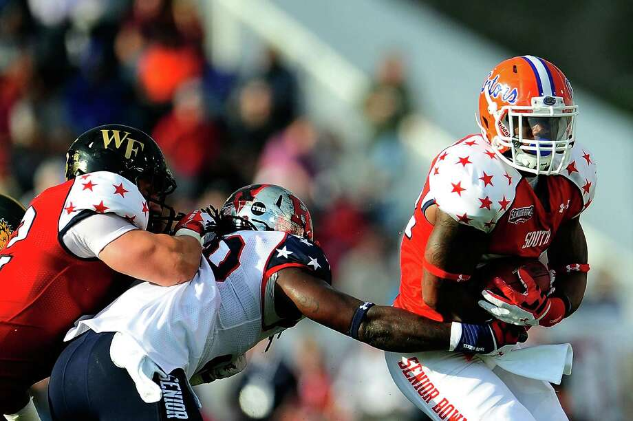 MOBILE, AL - JANUARY 26:  Mike Gillislee #22 of the South squad is pursued by Khaseem Greene #20 of the North squad during the first half of the Senior Bowl at Ladd Peebles Stadium on January 26, 2013 in Mobile, Alabama. Photo: Stacy Revere, Getty Images / 2013 Getty Images