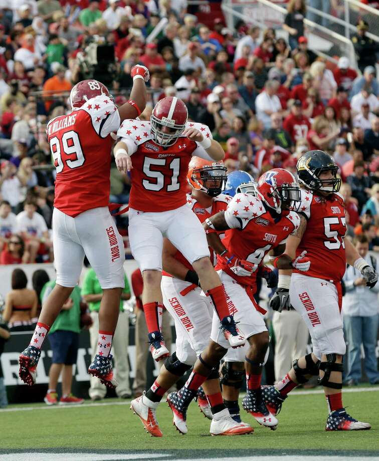 Senior Bowl South Squad tight end Michael Williams of Alabama (89) celebrates with teammate long snapper Carson Tinker of Alabama (51) after scoring in the first half of the Senior Bowl college football game at Ladd-Peebles Stadium in Mobile, Ala., Saturday, Jan. 26, 2013. (AP Photo/Dave Martin) Photo: Dave Martin, Associated Press / AP