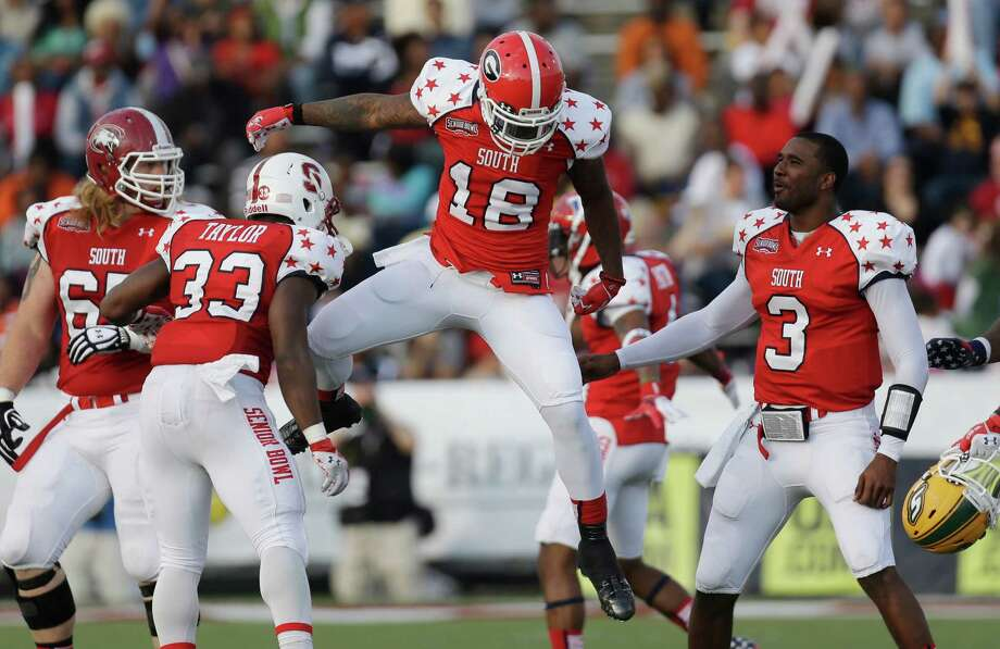 Senior Bowl South Squad defensive back Bacarri Rambo of Georgia (18) celebrates with teammates after making an interception in the first half of the Senior Bowl college football game at Ladd-Peebles Stadium in Mobile, Ala., Saturday, Jan. 26, 2013. At right is quarterback EJ Manuel of Florida State (3). At let is Senior Bowl South Squad running back Stepfan Taylor of Stanford (33). (AP Photo/Dave Martin) Photo: Dave Martin, Associated Press / AP