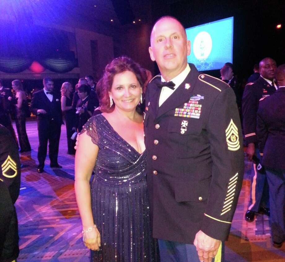 Courtesy CSM Frank Wicks New York Army National Guard Command Sgt. Maj. Frank Wicks and his wife Beth of West Sand Lake enjoy President Barack Obama?s inaugural ball on Monday in Washington.