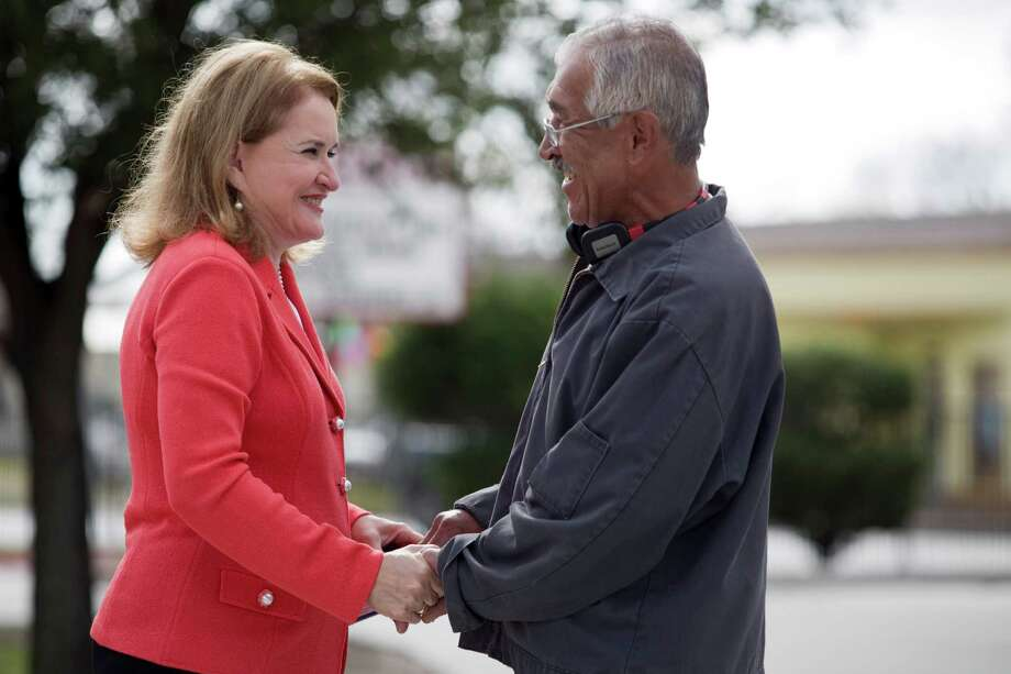 Edmundo Perez, right, talks with former county commissioner and city controller Sylvia Garcia as she campaigs to take over the former state senate district 6 seat of Mario Gallegos, Jan. 26, 2013 in Houston, TX. Photo: Eric Kayne, For The Chronicle / © 2013 Eric Kayne