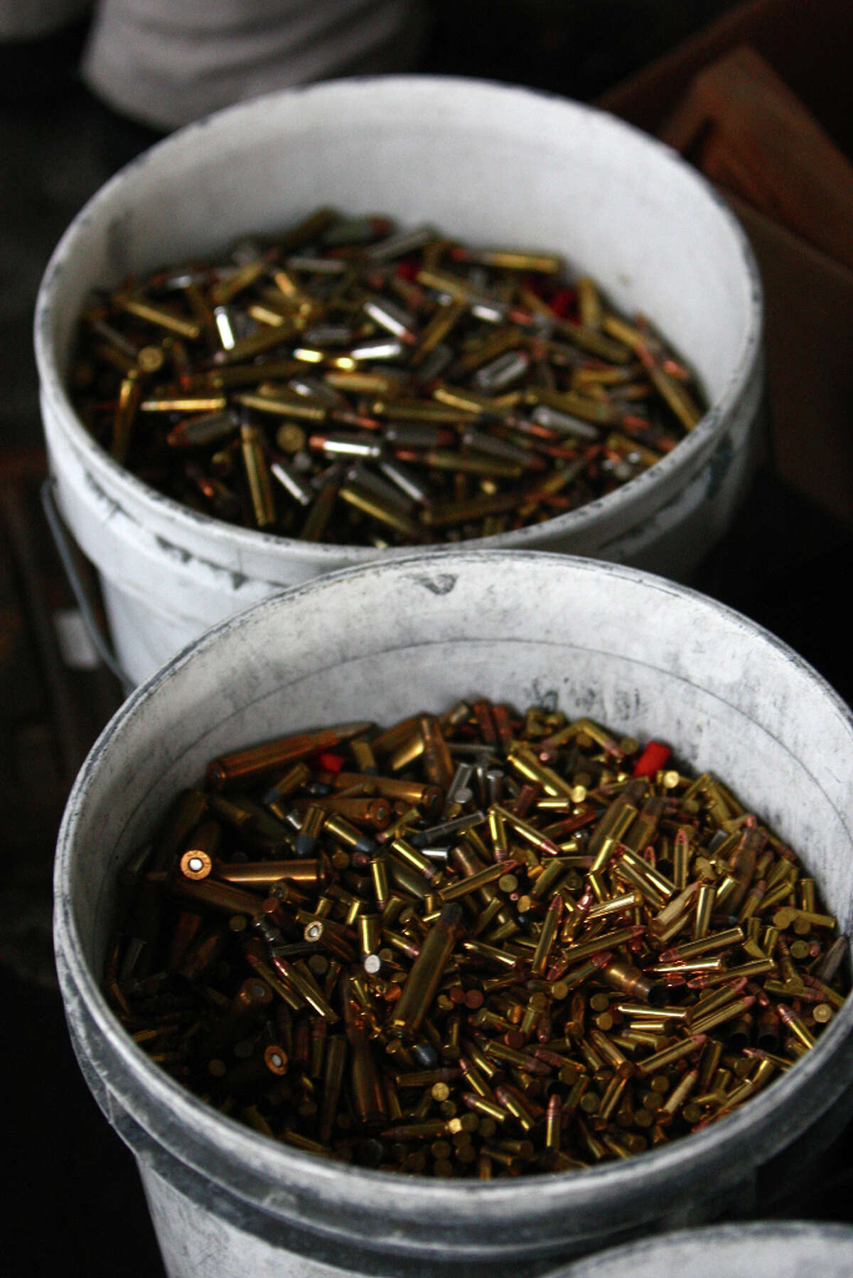 Buckets of collected ammunition are shown during the City of Seattle's gun buy back program on Saturday, January 26, 2013. The program handed out $80,000 worth of gift cards in exchange for weapons brought in by the public.