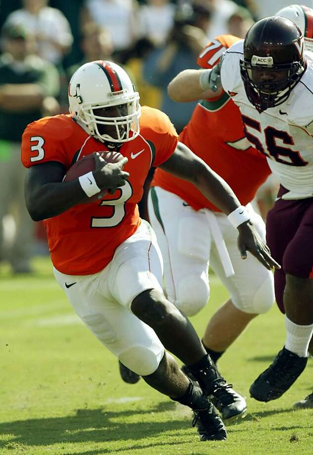 Frank Gore overcame two torn ACLs in college at Miami, above, and a broken ankle in high school. His jersey remains on display at Coral Gables (Fla.) High, where he was a teammate of New Orleans linebacker Jonathan Vilma. Photo: Li, AP