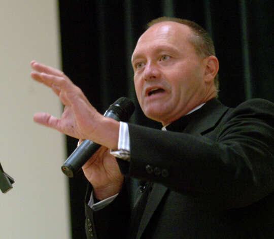 In this file photo Monsignor Kevin Wallin addresses the faithful, a packed house, at the Cathloic Center on Jewett Avenue, in Bridgeport, Conn. May 4th, 2006. Photo: File Photo / The News-Times File Photo
