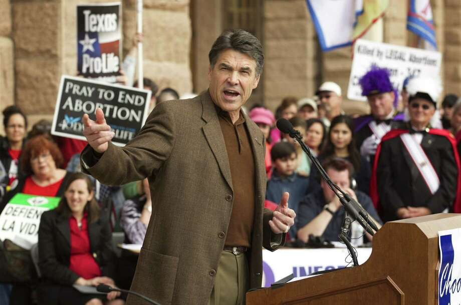 Gov. Rick Perry speaks during the Rally for Life at the Capitol in Austin, Texas, on Saturday, Jan. 26, 2013. Hundreds attended the pro-life rally that came on the heels of the 40th anniversary of the Roe v. Wade decision. Perry said Texas will do all it can to make abortions as rare as possible. (AP Photo/Austin American-Statesman, Jay Janner) MAGS OUT; NO SALES; INTERNET AND TV MUST CREDIT PHOTOGRAPHER AND STATESMAN.COM Photo: Jay Janner, MBO / Austin American-Statesman