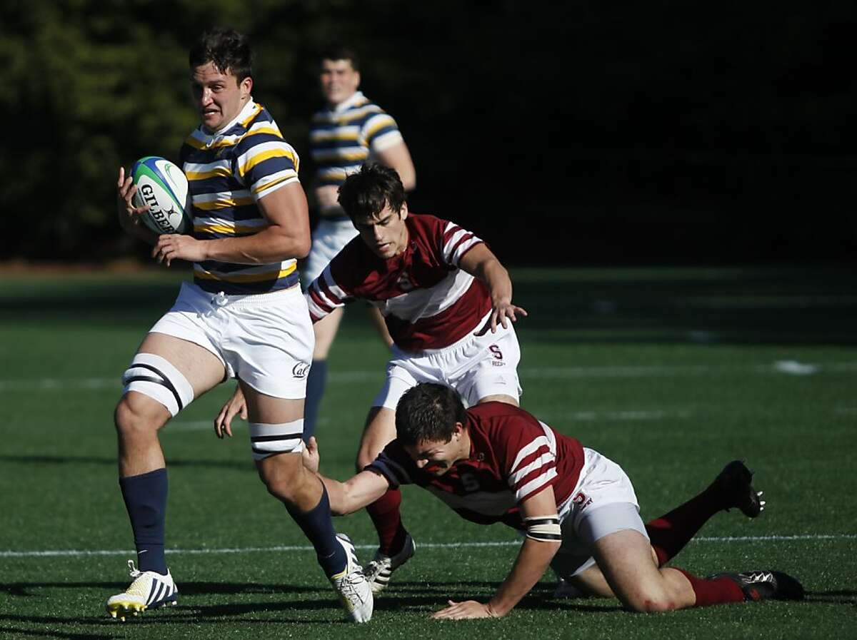Number 8 Tiaan De Nysschen carries the ball up the field for Cal against Stanford during the Battle for the Scrum Axe match at Witter Field in Berkeley Calif. on Saturday, Jan. 26, 2013. He scored one try during the match.