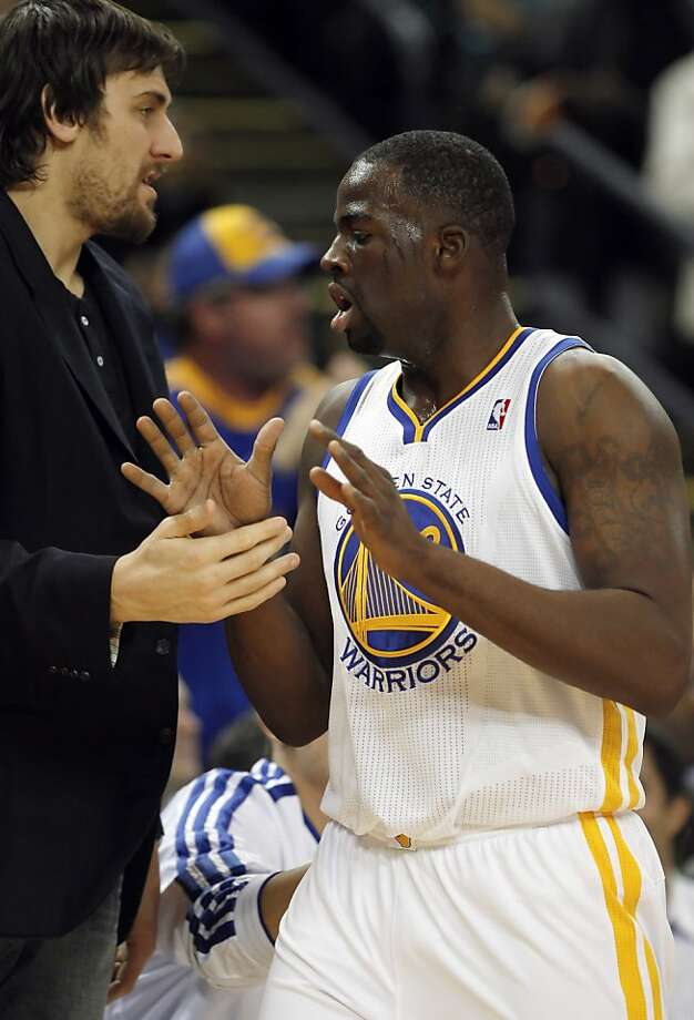 Draymond Green gets a high five from Andrew Bogut in the first half. The Golden State Warriors played the New Orleans Hornets at OracleArena in Oakland, Calif., on Tuesday, December 18, 2012, defeating the Hornets 103-96 Photo: Carlos Avila Gonzalez, The Chronicle