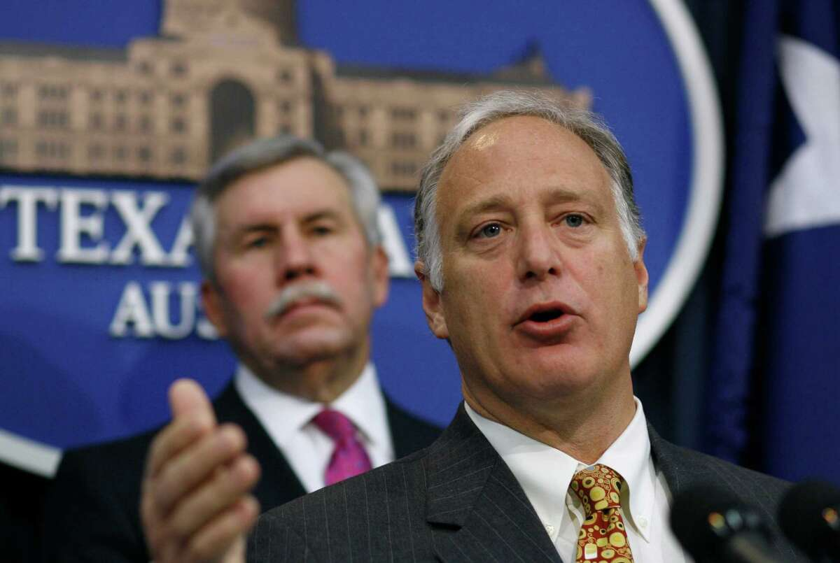 Sen. Kirk Watson, D-Austin, right, speaks during a news conference Monday, Feb. 2, 2009, in Austin, Texas. Sen. Troy Fraser,R-Horsehoe Bay, is on the left. Clean power proponents and lawmakers released a study on solar power's job creation and energy savings potential in Texas and to highlight bipartisan support for increasing solar power generation in Texas. (AP Photo/Harry Cabluck)