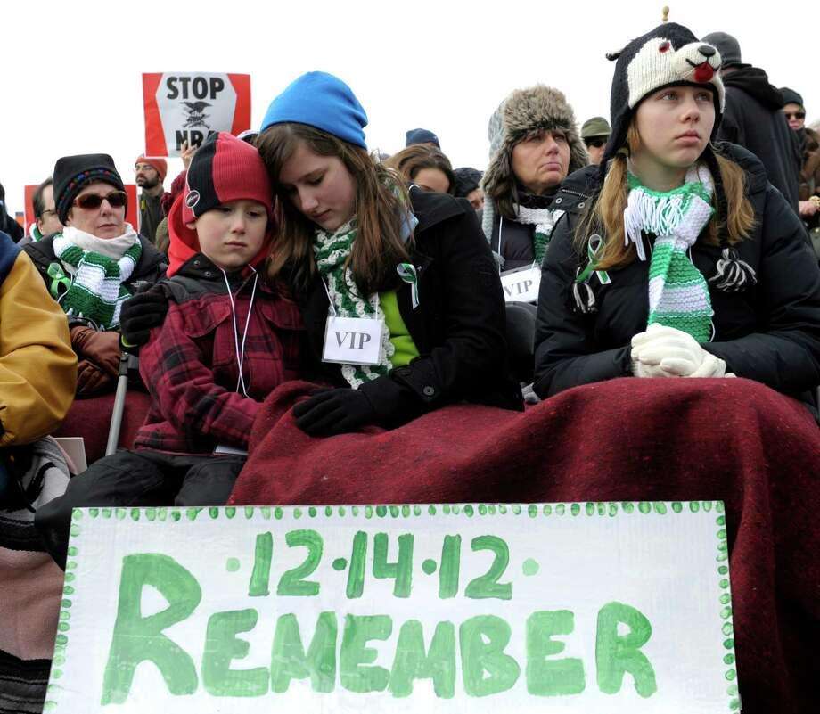 People listens to speaker during a rally against gun violence near the Washington Monument in Washington, Thursday, Jan. 26, 2012. (AP Photo/Susan Walsh) Photo: Susan Walsh
