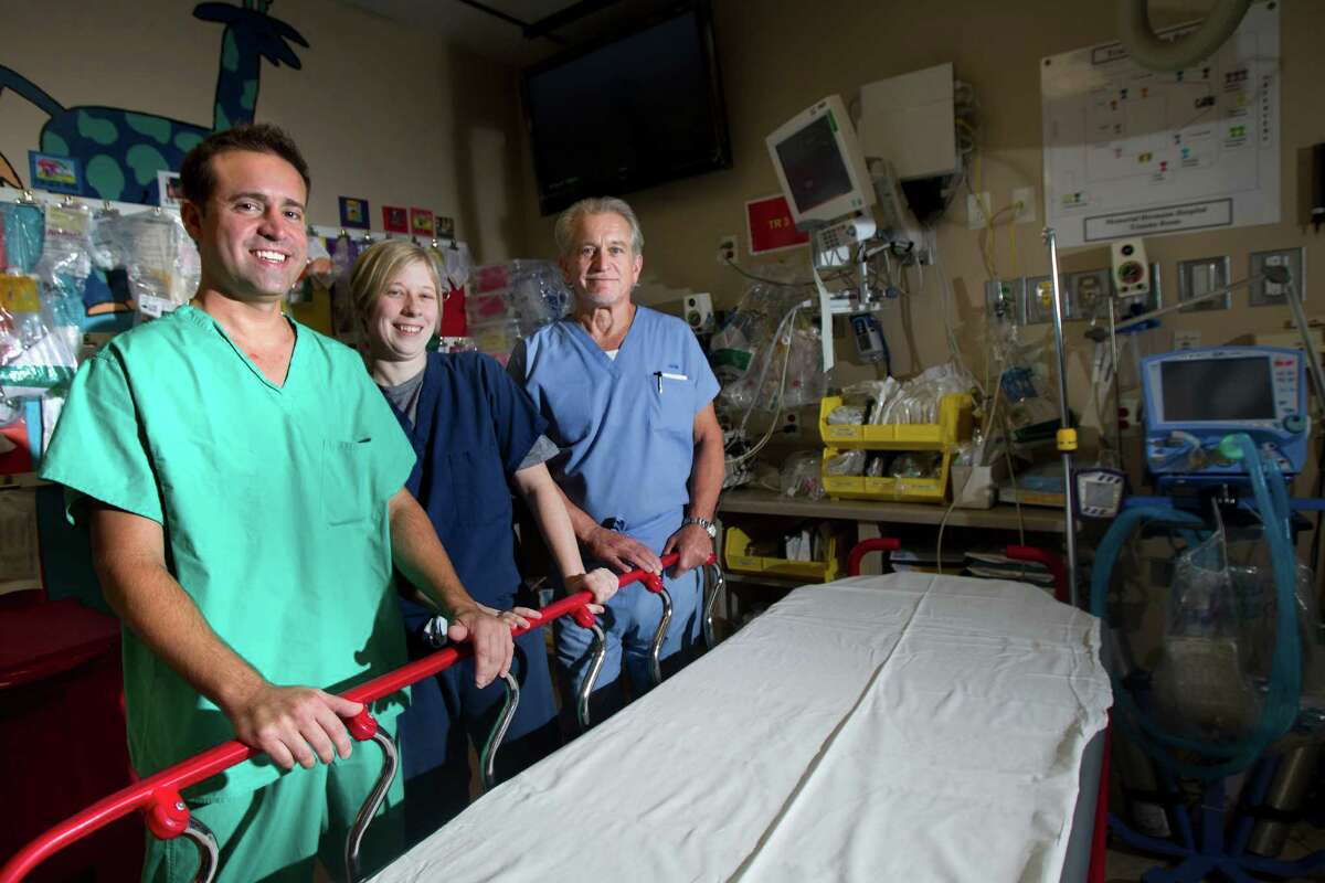 Drs. Ron Albarado, left, Laura Kreiner and Phil Adams operated on Hayden at Memorial Hermann's Texas Trauma Institute. Albardo described the delicate process of repairing his inferior vena cava as trying to