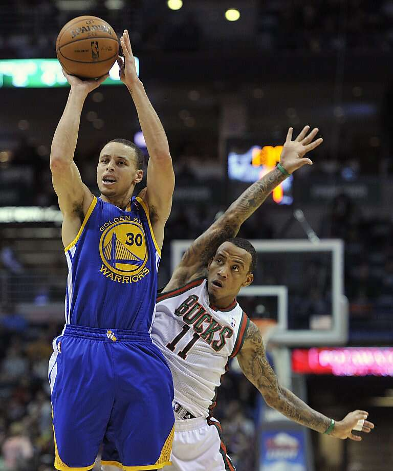 Golden State Warriors' Stephen Curry (30) shoots a three-point basket as Milwaukee Bucks' Monta Ellis (11) defends during the first half of an NBA basketball game on Saturday, Jan. 26, 2013, in Milwaukee. (AP Photo/Jim Prisching) Photo: Jim Prisching, Associated Press