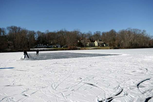 Children and adults play ice hockey on the frozen water at Gorham's Pond in Darien on Saturday, January 27, 2013. Photo: Lindsay Perry / Stamford Advocate