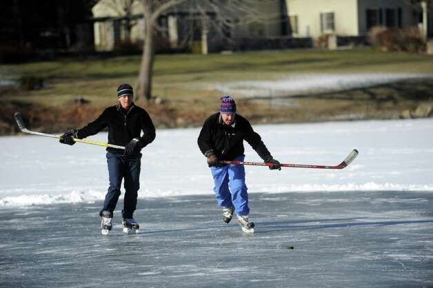 Brenda and Jim Crane play ice hockey on Gorham's Pond in Darien on Saturday, January 27, 2013. Photo: Lindsay Perry / Stamford Advocate