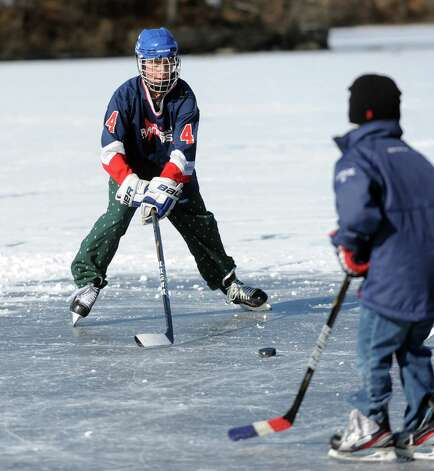 Herbie Hazelton, 14, plays ice hockey on the frozen water at Gorham's Pond in Darien on Saturday, January 27, 2013. Photo: Lindsay Perry / Stamford Advocate