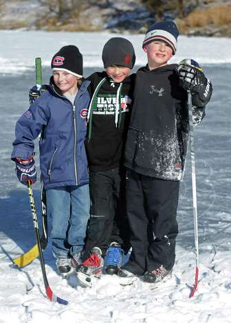 9-year-old friends, from left, Will Lodge, Mike Petersen and David Pozma pose for a photo after ice skating on Gorham's Pond in Darien on Saturday, January 27, 2013. Photo: Lindsay Perry / Stamford Advocate