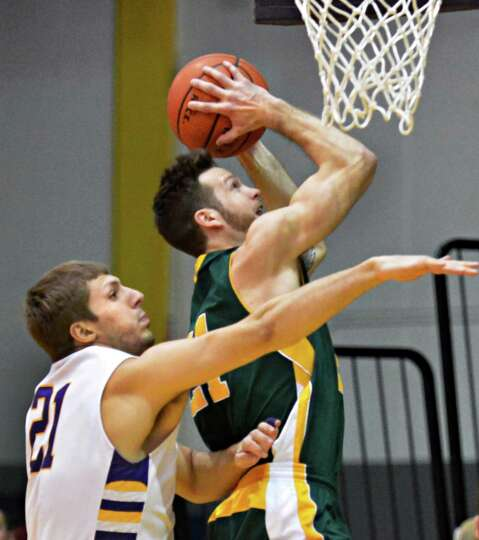 Vermont's #21 Candon Rusin and UAlbany's #21 Blake Metcalf during an America East game at Sefcu Aren