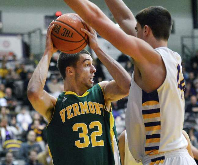 Vermont's #32 Ethan O'Day, left, and UAlbany's #14 Sam Rowley during an America East game at Sefcu A