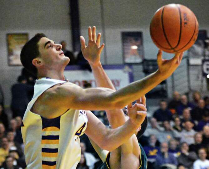 UAlbany's #44 John Puk goes to the basket against Vermont during an America East game at Sefcu Arena