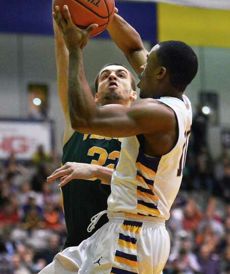 Vermont's #32 Ethan O'Day, left, and UAlbany's #10 Mike Black during an America East game at Sefcu A