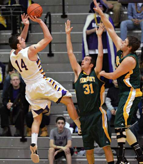 UAlbany's #14 gets a shot off  against Vermont's defense during an America East game at Sefcu Arena
