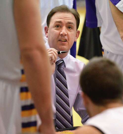 UAlbany head coach Will Brown with players during a time out during Saturday's game against Vermont