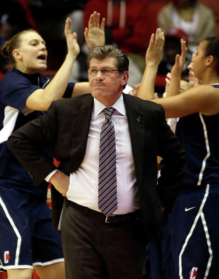 Connecticut head coach Geno Auriemma watches from the sidelines after the team scored a basket against Cincinnati in the first half of an NCAA college basketball game on Saturday, Jan. 26, 2013, in Cincinnati. (AP Photo/Al Behrman) Photo: Al Behrman, Associated Press / AP