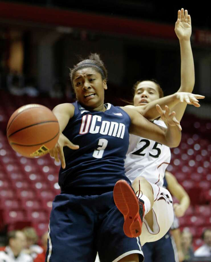 Connecticut forward Morgan Tuck (3) chases a rebound with Cincinnati guard Chelsea Jamison (25) in the first half of an NCAA college basketball game on Saturday, Jan. 26, 2013, in Cincinnati. (AP Photo/Al Behrman) Photo: Al Behrman, Associated Press / AP