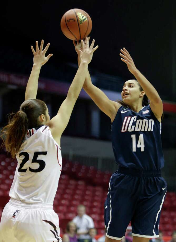 Connecticut guard Bria Hartley (14) shoots over Cincinnati guard Chelsea Jamison (25) in the first half of an NCAA college basketball game on Saturday, Jan. 26, 2013, in Cincinnati. (AP Photo/Al Behrman) Photo: Al Behrman, Associated Press / AP