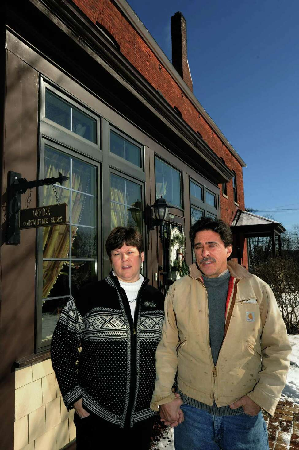 Jules and her husband Joseph Constantine in front of their office for Constantine Builders Inc. on Saturday Jan. 26,2013 in Amsterdam, N.Y. (Michael P. Farrell/Times Union)