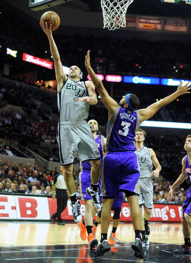 Manu Ginobili of the Spurs shoots and scores over Jared Dudley of the Phoenix Suns at the AT&T Center on Saturday, Jan. 26, 2013. Photo: Billy Calzada, San Antonio Express-News / SAN ANTONIO EXPRESS-NEWS