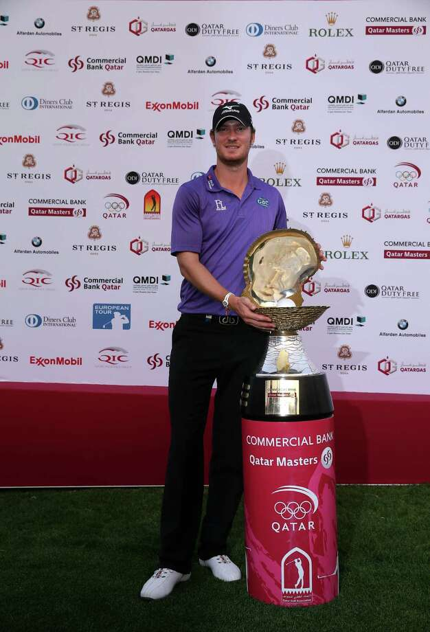 DOHA, QATAR - JANUARY 26:  Chris Wood of England poses with the trophy after winning the Commercial Bank Qatar Masters held at Doha Golf Club on January 26, 2013 in Doha, Qatar.  (Photo by Andrew Redington/Getty Images) Photo: Andrew Redington