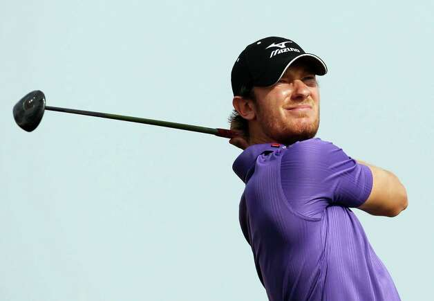 England's Chris Wood plays a shot during the final round of the Qatar Masters Golf Tournament in the capital Doha, Qatar, Saturday, Jan. 26, 2013. (AP Photo/Osama Faisal) Photo: OSAMA FAISAL