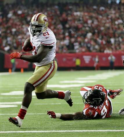 San Francisco 49ers' Frank Gore gets away from Atlanta Falcons' Jonathan Babineaux (95) for a five-yard touchdown run during the second half of the NFL football NFC Championship game Sunday, Jan. 20, 2013, in Atlanta. (AP Photo/Mark Humphrey) Photo: Mark Humphrey