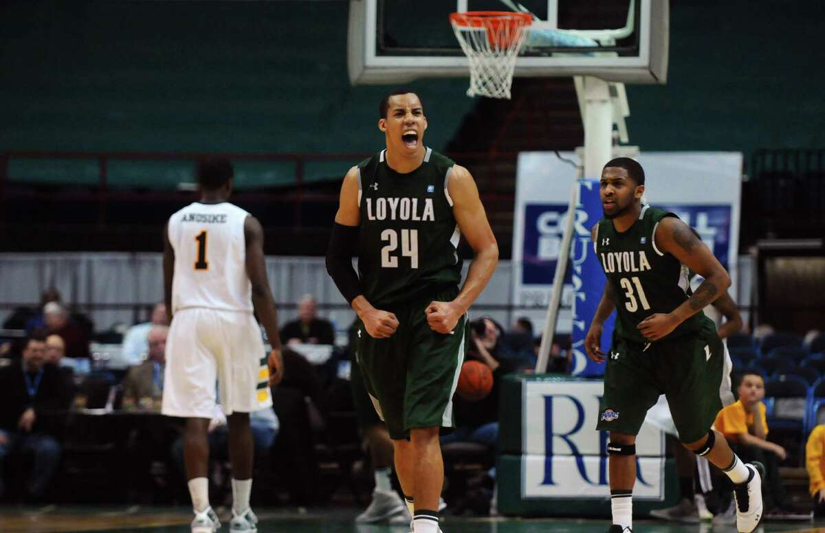 Loyola's Erik Etherly celebrates a teammate scoring in the final seconds in the second half of Siena's 76-69 loss to Loyola at the Times Union Center in Albany, NY on Monday February 7, 2011. ( Philip Kamrass / Times Union )
