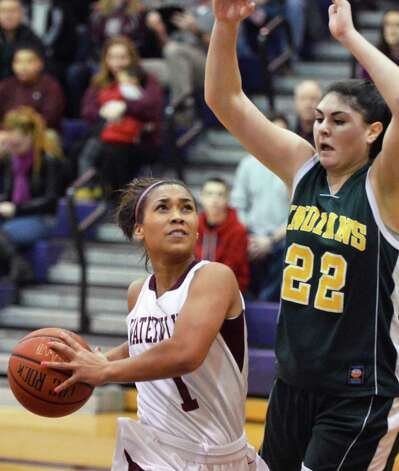Vliet guard Ailayia Demand, left, gets past Ravena's @22 Kayla Hotaling during a game at the Colonial Council Coaches vs. Cancer event at Voorheesville High Saturday Jan. 26, 2013.  (John Carl D'Annibale / Times Union) Photo: John Carl D'Annibale / 10020887A