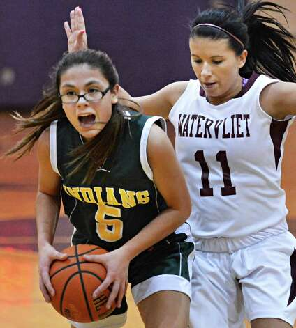 Ravena's #5 Jasmine Powell, left, and Vliet's #11 Kornelia Sziller during a game at the Colonial Council Coaches vs. Cancer event at Voorheesville High Saturday Jan. 26, 2013.  (John Carl D'Annibale / Times Union) Photo: John Carl D'Annibale / 10020887A