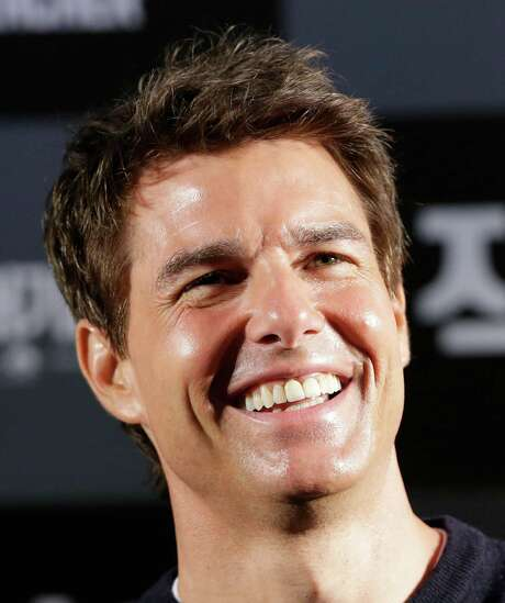 """U.S. actor Tom Cruise smiles during a news conference to promote his film """"Jack Reacher"""" in Seoul, South Korea, Thursday, Jan. 10, 2013. Even though he turned 50 last summer and has been a Hollywood star for three decades, Tom Cruise says he still has fun making movies. (AP Photo/Lee Jin-man) Photo: Lee Jin-man, STF / AP"""