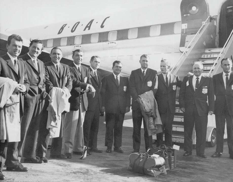Jackie Burke Jr., left, who played in the Ryder Cup five times, also served as the team captain for the 1957 U.S. squad posing here after landing in London. / AP1957