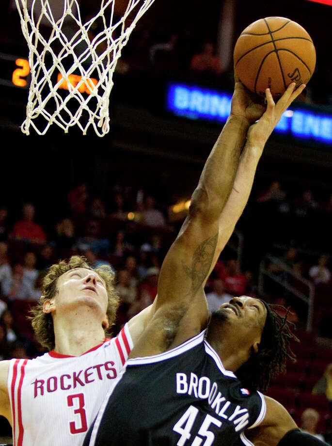 Jan. 26: Rockets 119, Nets 106Rockets center Omer Asik (3) battles for a rebound with Nets forward Gerald Wallace. Photo: Brett Coomer, Chronicle / © 2013 Houston Chronicle