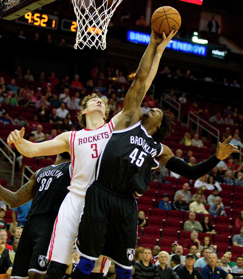 Rockets center Omer Asik (3) battles for a rebound with Nets forward Gerald Wallace. Photo: Brett Coomer, Chronicle / © 2013 Houston Chronicle